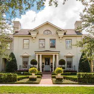 Inspiration for a timeless beige two-story gable roof remodel in Orlando