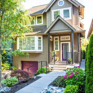 Example of a classic brown two-story exterior home design in Vancouver