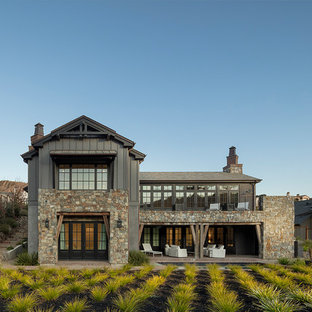 Inspiration for a rustic gray two-story mixed siding exterior home remodel in San Francisco with a shingle roof