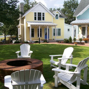 Example of a beach style wood gable roof design in Atlanta