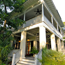 Tropical Exterior by WaterMark Coastal Homes, LLC