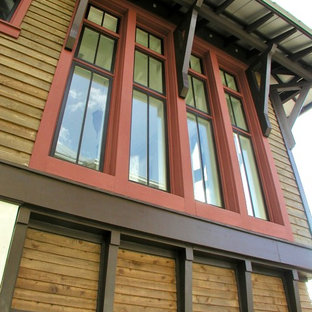 Mid-sized tropical multicolored two-story wood house exterior idea with a hip roof and a metal roof