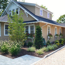 Traditional Exterior by Bay Gardens