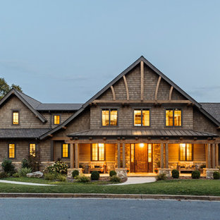 Large rustic brown two-story wood gable roof idea in Other with a mixed material roof