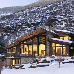 Large rustic two-story mixed siding exterior home idea in Denver with a shed roof