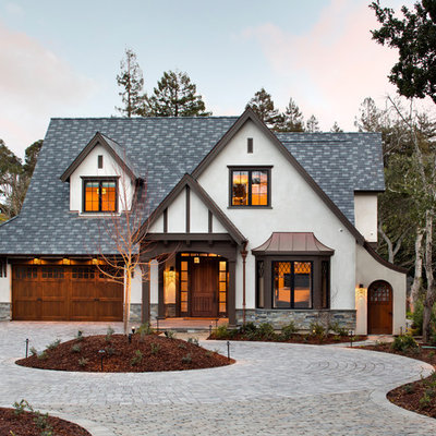 Mid-sized elegant white two-story stucco house exterior photo in San Francisco with a hip roof and a shingle roof