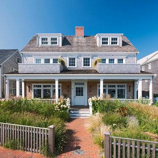 Beach style brown two-story exterior home idea in Boston with a shingle roof