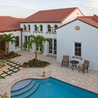 Tuscan two-story exterior home photo in Miami
