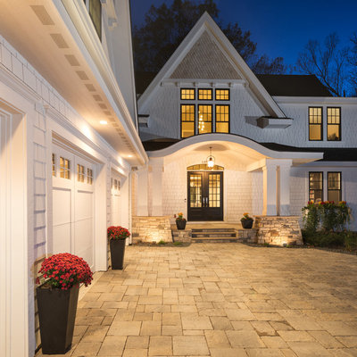 Inspiration for a huge transitional white three-story concrete fiberboard exterior home remodel in Minneapolis with a shingle roof