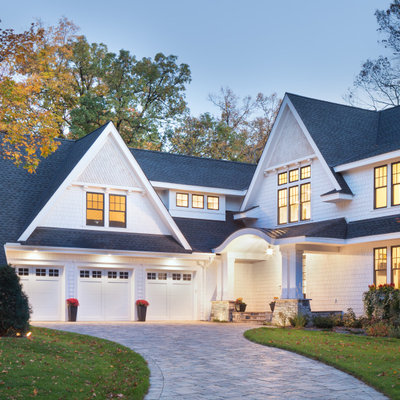 Example of a huge transitional white three-story concrete fiberboard exterior home design in Minneapolis with a shingle roof