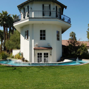 Inspiration for a mediterranean white exterior home remodel in Phoenix