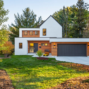 Example of a trendy multicolored two-story mixed siding exterior home design in Minneapolis