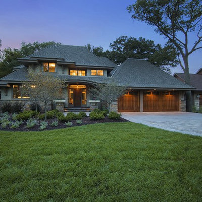 Example of an arts and crafts green exterior home design in Minneapolis