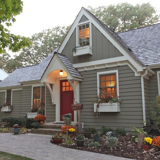 Mid-sized elegant green two-story mixed siding exterior home photo in Minneapolis