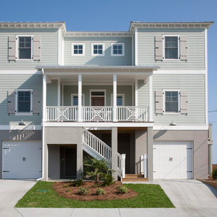 Inspiration for a large beach style gray three-story exterior home remodel in Charleston