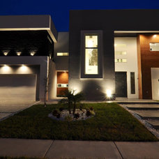 Modern Exterior by Home & Commercial Designs