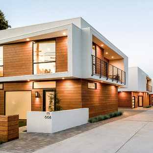 Mid-sized minimalist two-story stucco apartment exterior photo in San Francisco