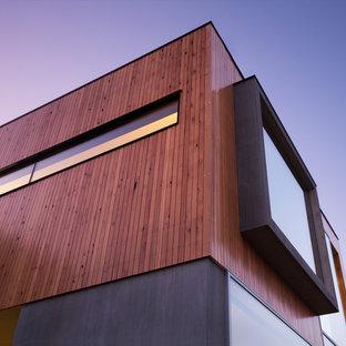 Inredning av ett modernt stort grått betonghus, med två våningar och platt tak