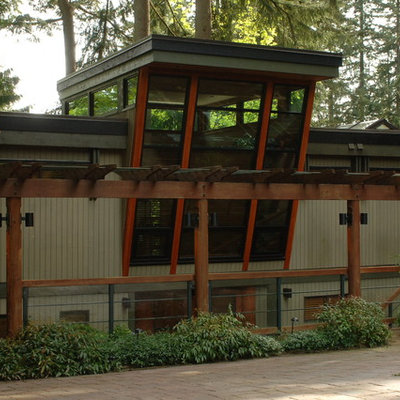 Inspiration for a large contemporary multicolored two-story wood exterior home remodel in Vancouver