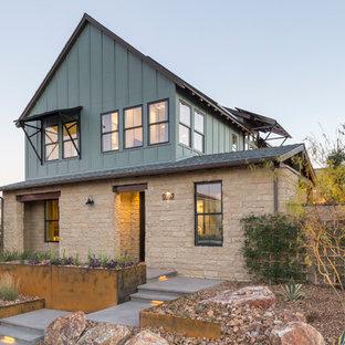 Imagen de fachada de casa de estilo de casa de campo, de dos plantas, con revestimientos combinados y tejado a dos aguas