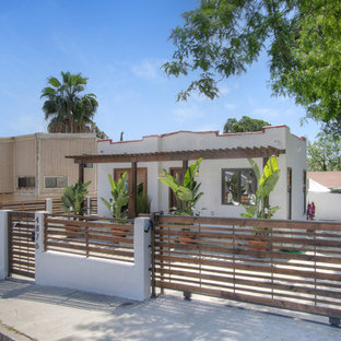 Inspiration for a small eclectic white one-story stucco exterior home remodel in Los Angeles