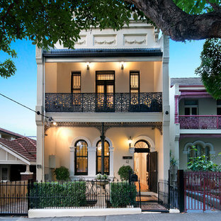 Inspiration for a traditional two-storey beige house exterior in Newcastle - Maitland with a flat roof.