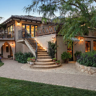 Large mediterranean beige two-story stucco exterior home idea in Santa Barbara