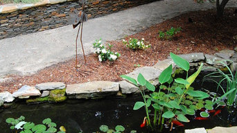Elegant stone wall and pond in North Raleigh