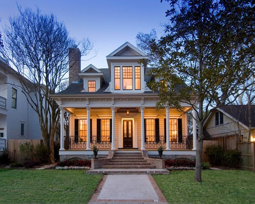 Small ornate two-story exterior home photo in Houston & Front Entrance Lighting | Houzz azcodes.com