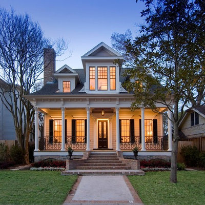 Small ornate two-story exterior home photo in Houston