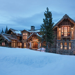 Example of a mountain style stone exterior home design in Other
