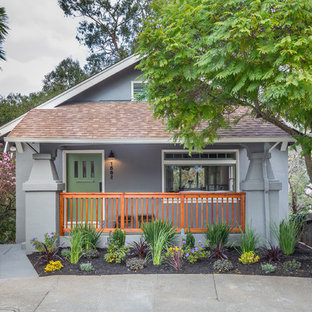 Mid-sized eclectic gray one-story stucco gable roof photo in San Francisco