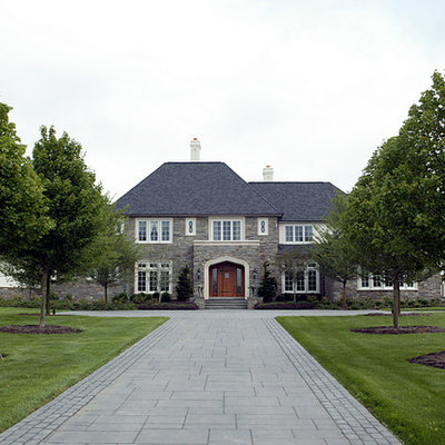 Example of a large classic two-story stone exterior home design in Philadelphia
