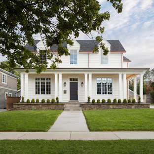 Example of a country white two-story exterior home design in Salt Lake City with a shingle roof