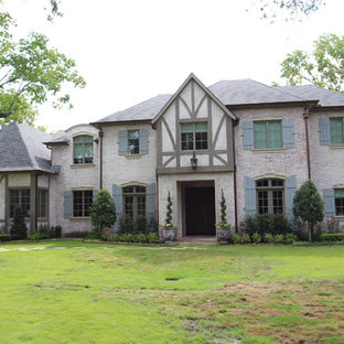 Large danish gray two-story stone gable roof photo in Houston