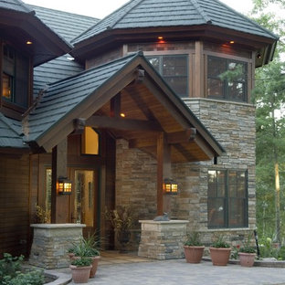 Inspiration for a rustic stone exterior home remodel in Minneapolis