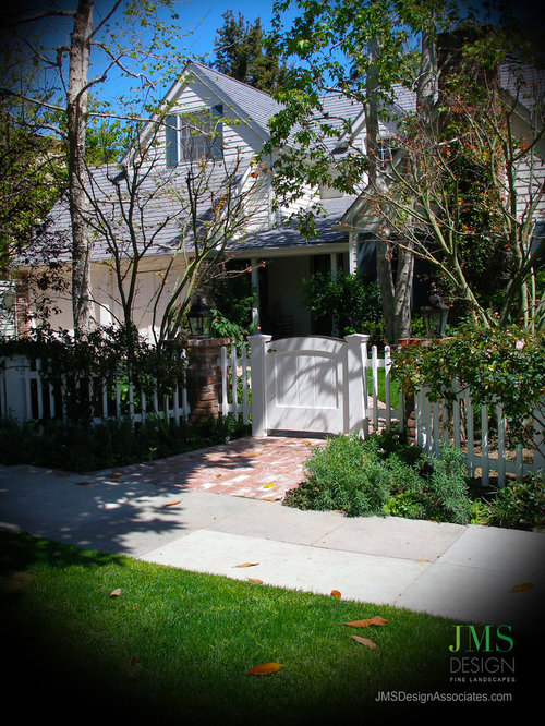 Small Cottage Chic White One Story Wood Exterior Home Photo In Los Angeles