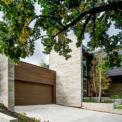 Large contemporary two-story mixed siding house exterior idea in Chicago