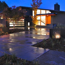 Midcentury Exterior by Group3 Architects llc