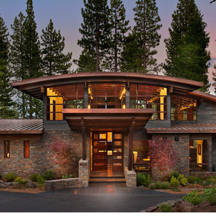 Inspiration for a rustic two-story stone exterior home remodel in Sacramento
