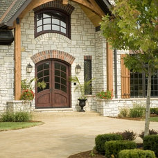 Eclectic Exterior by Rigsby Builders Inc.