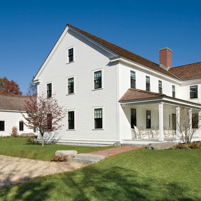 Large cottage white two-story wood exterior home photo in Boston