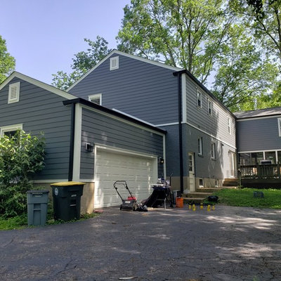 Example of a mid-sized classic gray two-story concrete fiberboard exterior home design in St Louis with a shingle roof