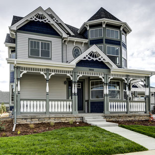 Victorian multicolored two-story wood exterior home idea in Denver with a shingle roof