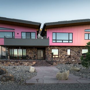Contemporary pink two-story mixed siding house exterior idea in Salt Lake City with a shed roof