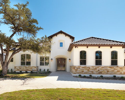 Example Of A Tuscan Stone Exterior Home Design In Austin With A Tile Roof