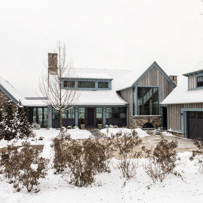 Country brown two-story wood gable roof idea in New York