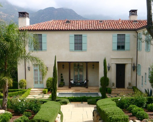Example Of A Tuscan Beige Two Story Exterior Home Design In Other With A Hip