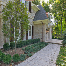 Traditional Exterior by L&L Builders Corp