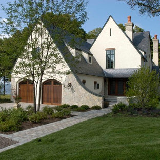 Huge traditional beige three-story stucco gable roof idea in Chicago